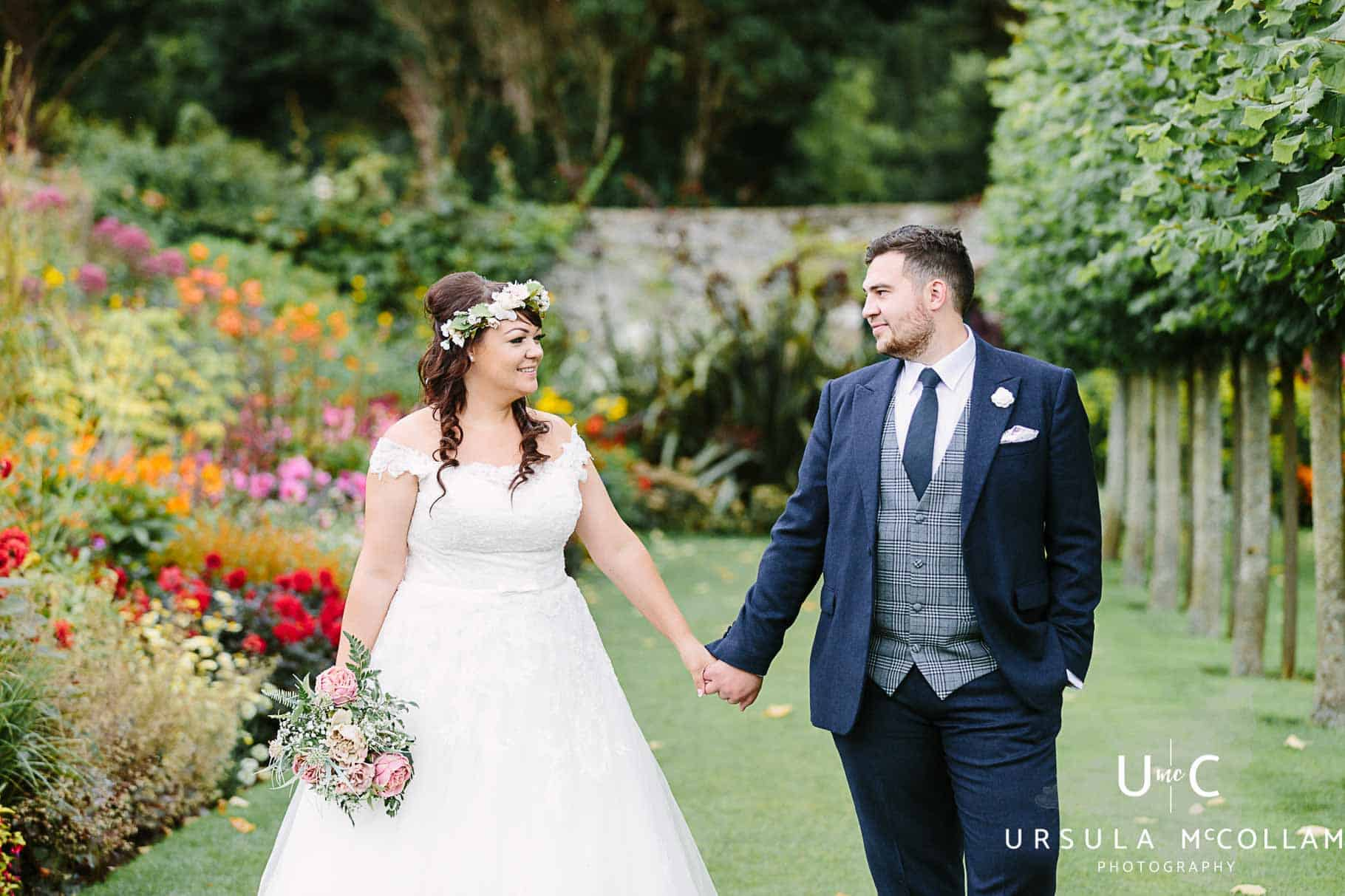 Bride and groom looking at each other in Glenarm Castle gardens