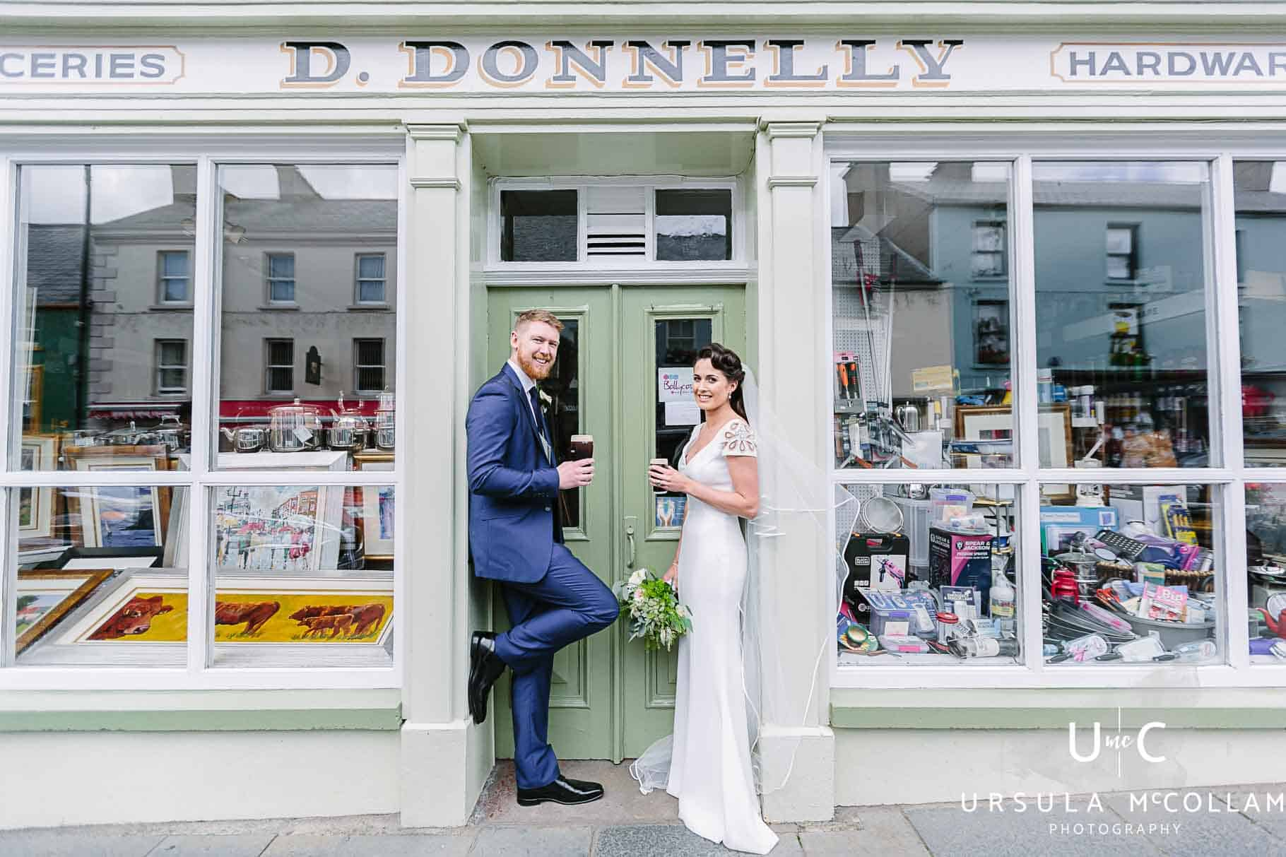 Bride and groom drinking guinness outside Donnellys shop in Ballycastle. The shop belongs to the brides dad