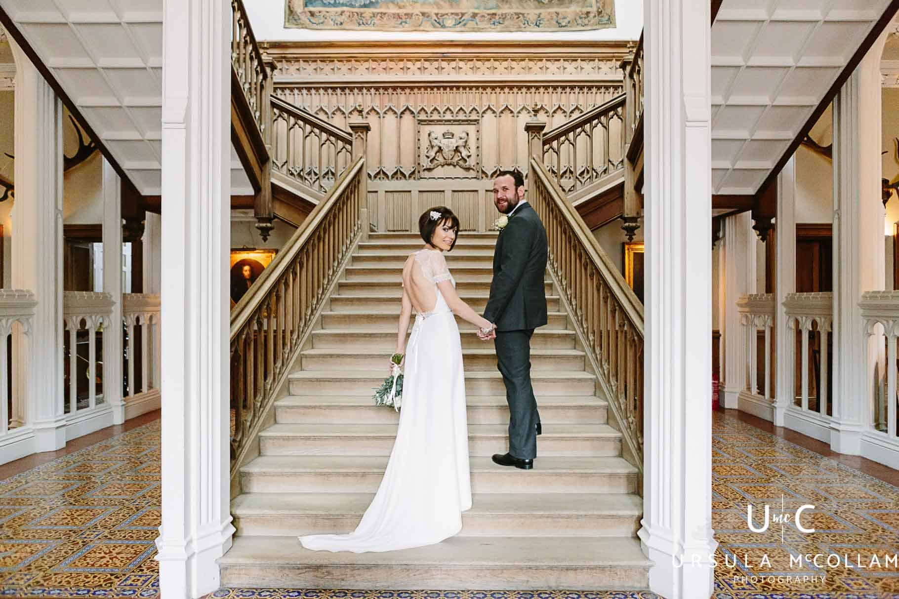 Bride and groom walking up the stairs at Crom Castle