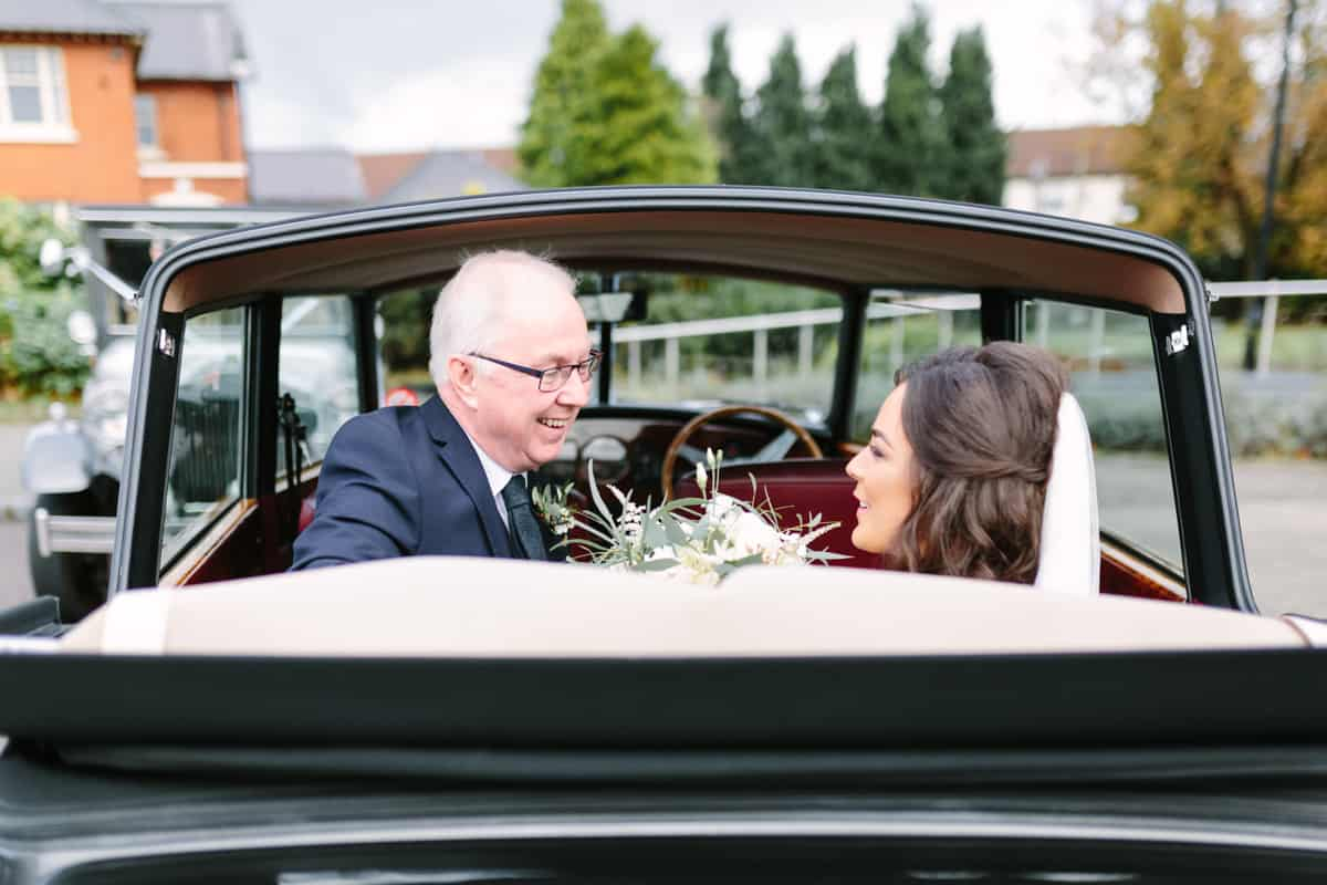 Bride and dad in car arriving at church