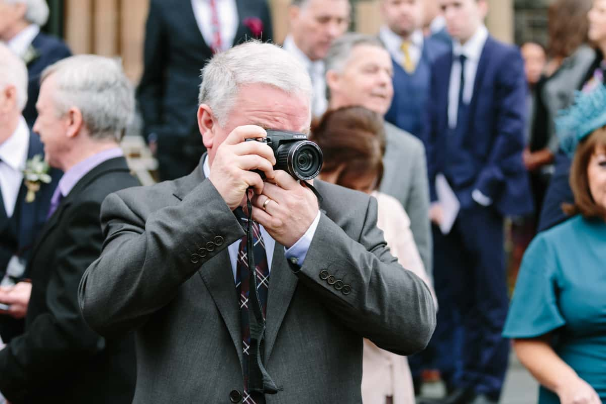 wedding guest taking a photograph