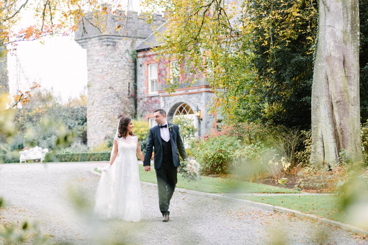 Bride and groom walking at Ballymagarvey Village