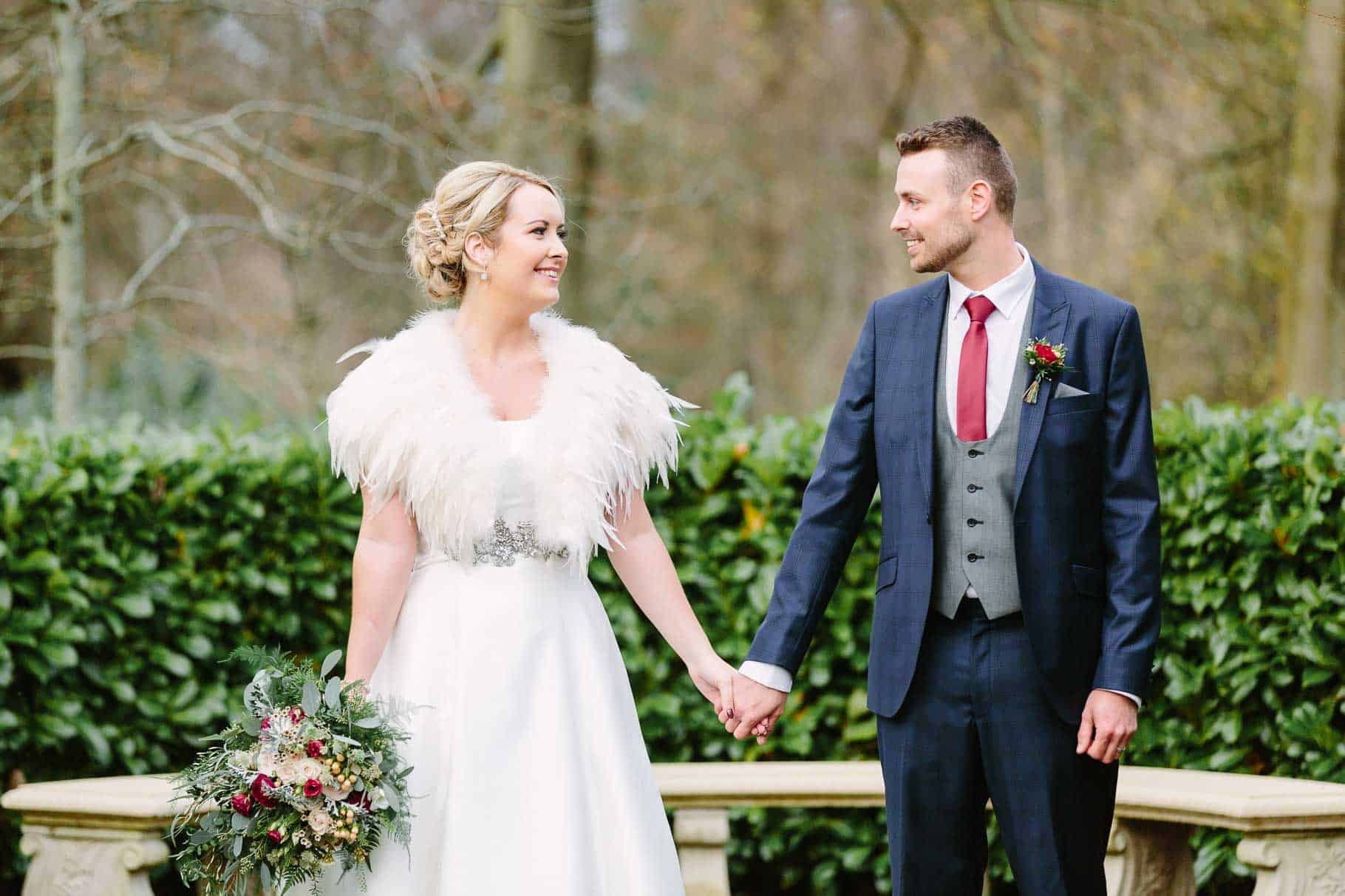 bride and groom holding hands and looking at each other in clandeboye lodge
