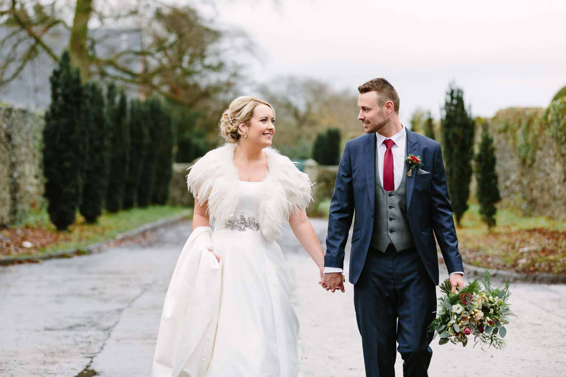 Bride and groom walking at Clandeboye Lodge