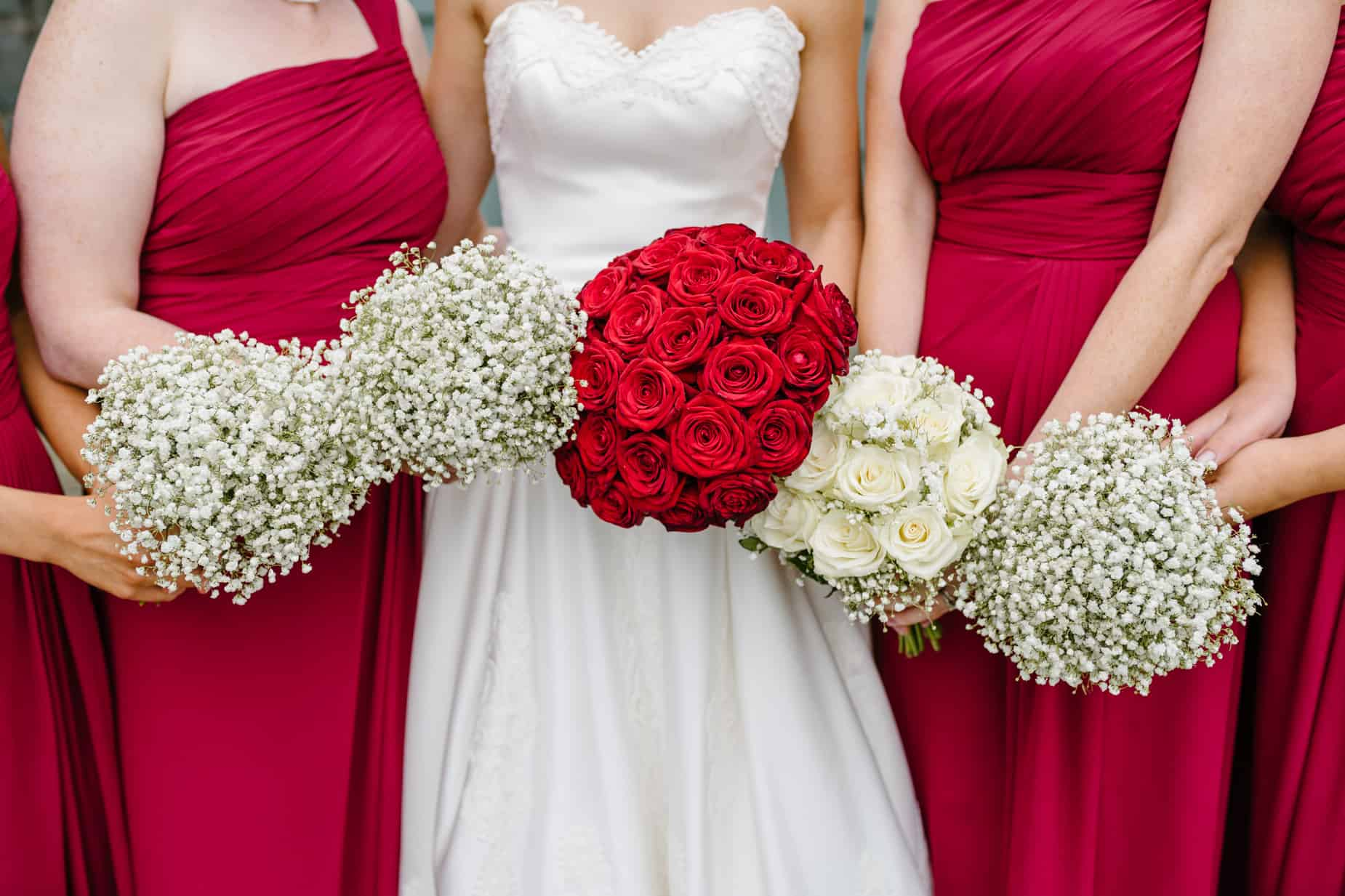 bride and bridesmaid and the contrasting wedding flowers