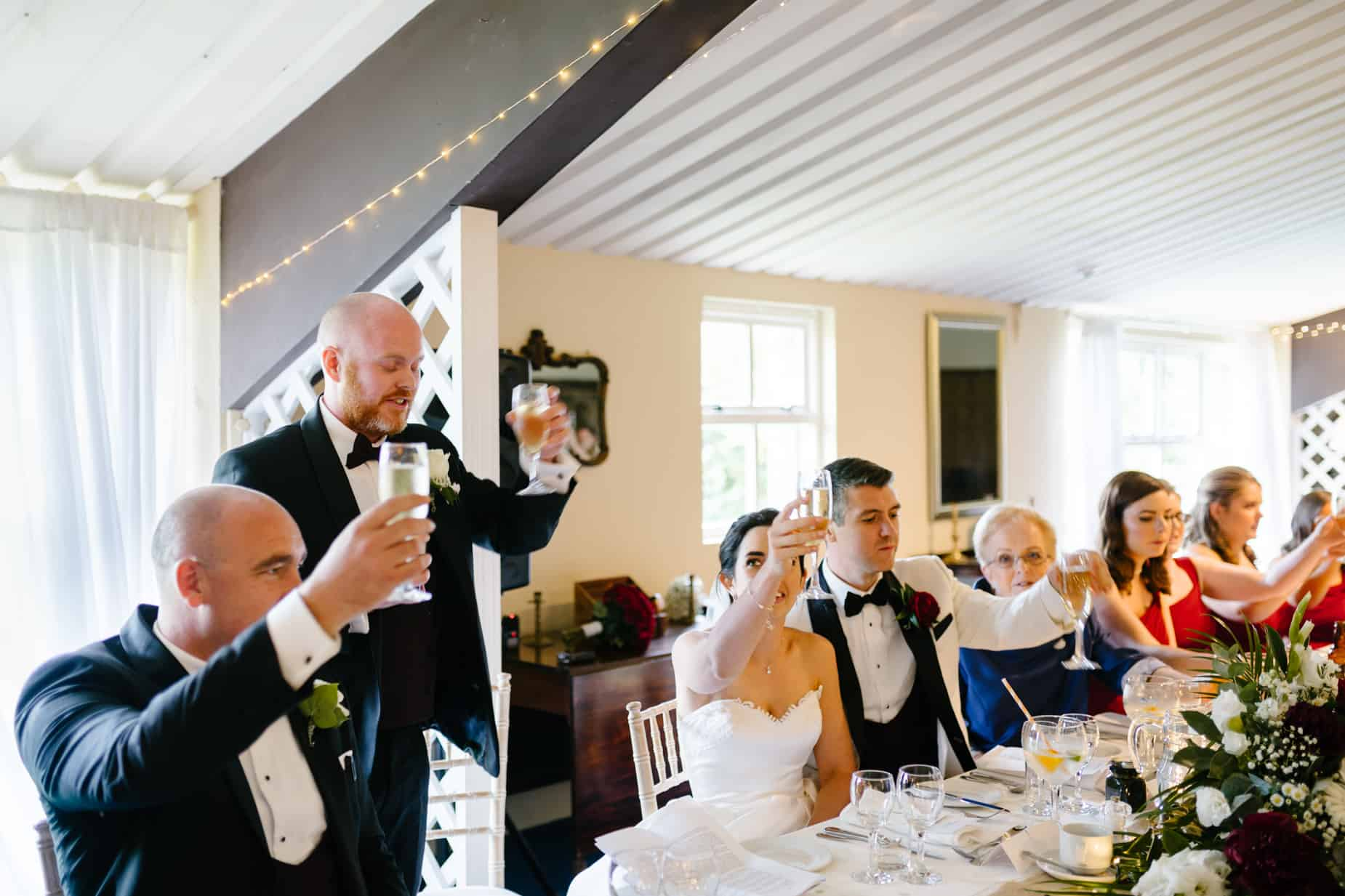 wedding party toasting the bride and groom