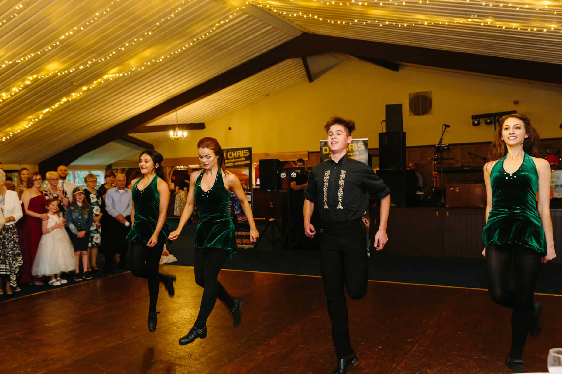 Irish dancers wearing green velvet dancing at a wedding