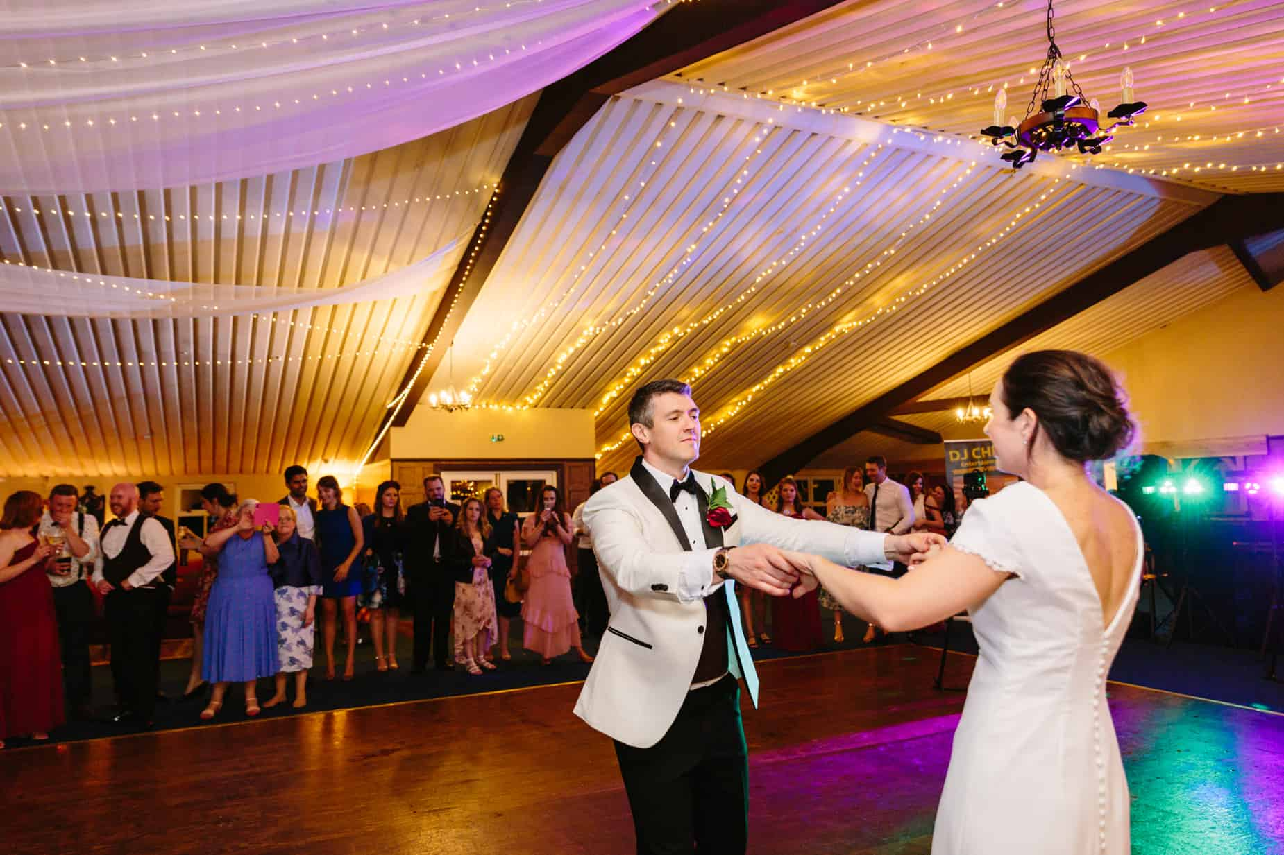 Bride and groom dancing on dance floor